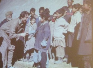 Greg Mortenson greets students in Korphe, Pakistan, the village where the Central Asia Institute built its first school with the support of Haji Ali, Mortenson's mentor and inspiration.